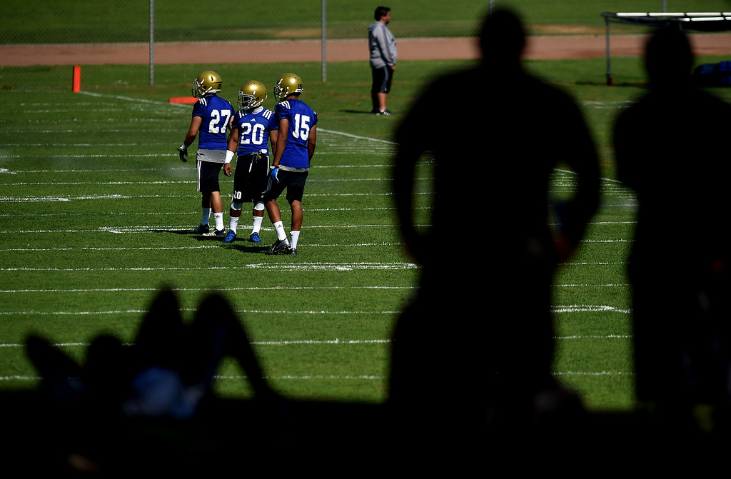 . Fans watch as the UCLA Bruins hold football practice at Cal State San Bernardino in San Bernardino, CA, Monday, August 4, 2014. (Photo by Jennifer Cappuccio Maher/Inland Valley Daily Bulletin)