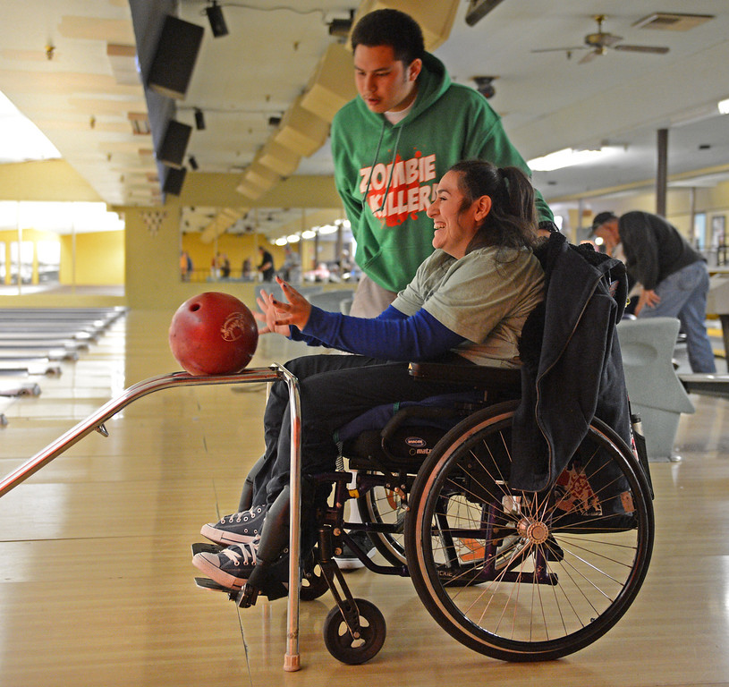 . Marc DeCastro aids Olivia Delgado in aiming the ball as she bowls at Palos Verdes Bowl in Torrance. Photo by Brad Graverson/LANG