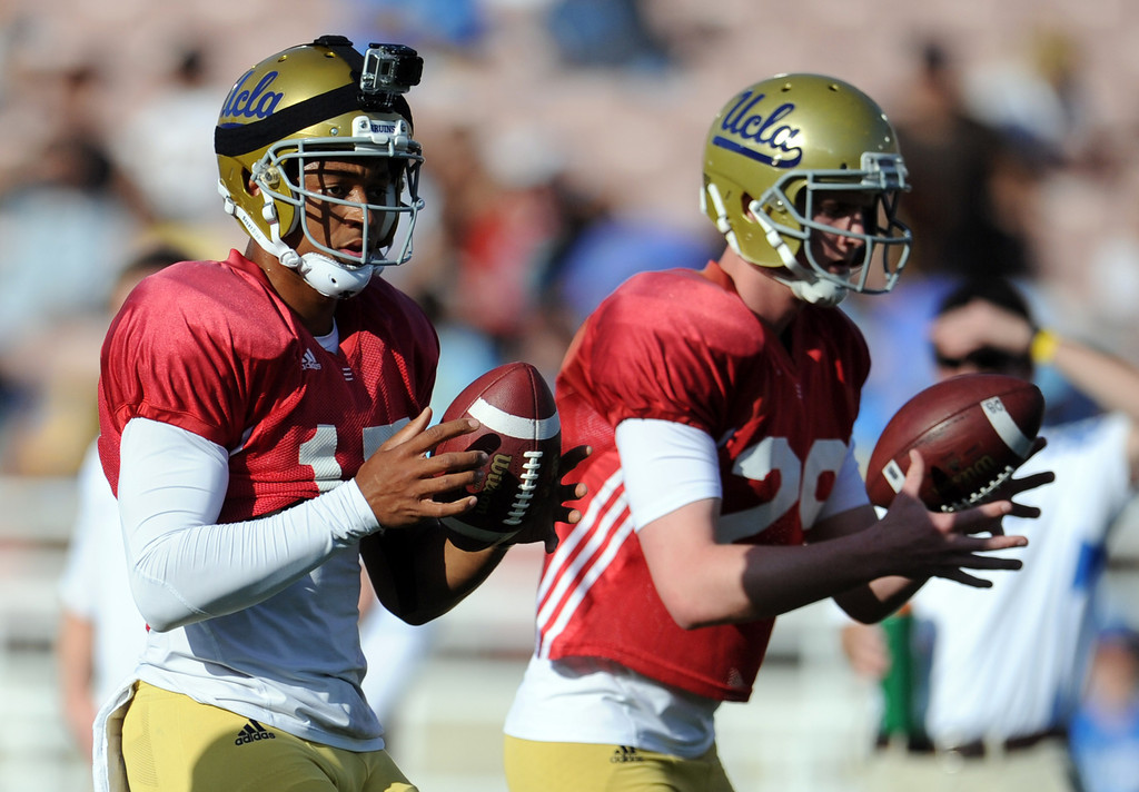 Description of . UCLA quarterback Brett Hundley (17), left, with quarterback Jake Hall (29) during the football spring showcase college football game in the Rose Bowl on Saturday, April 27, 2013 in Pasadena, Calif.    (Keith Birmingham Pasadena Star-News)