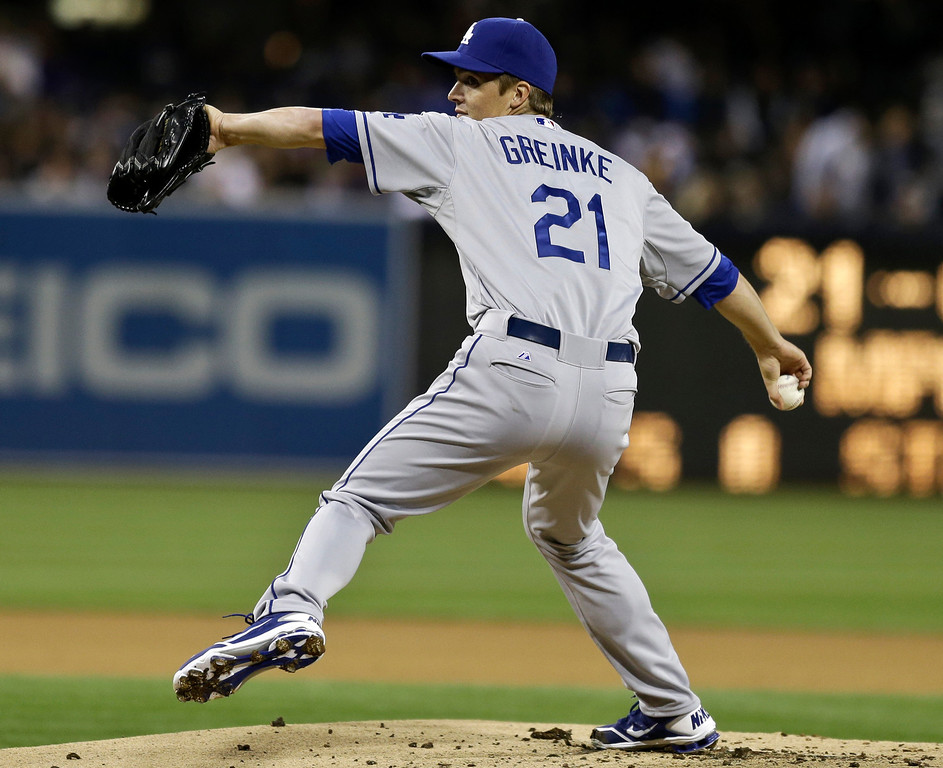 . Los Angeles Dodgers starting pitcher Zack Greinke works  against the San Diego Padres during the first inning of a baseball game in San Diego, Thursday, April 11, 2013. (AP Photo/Lenny Ignelzi)