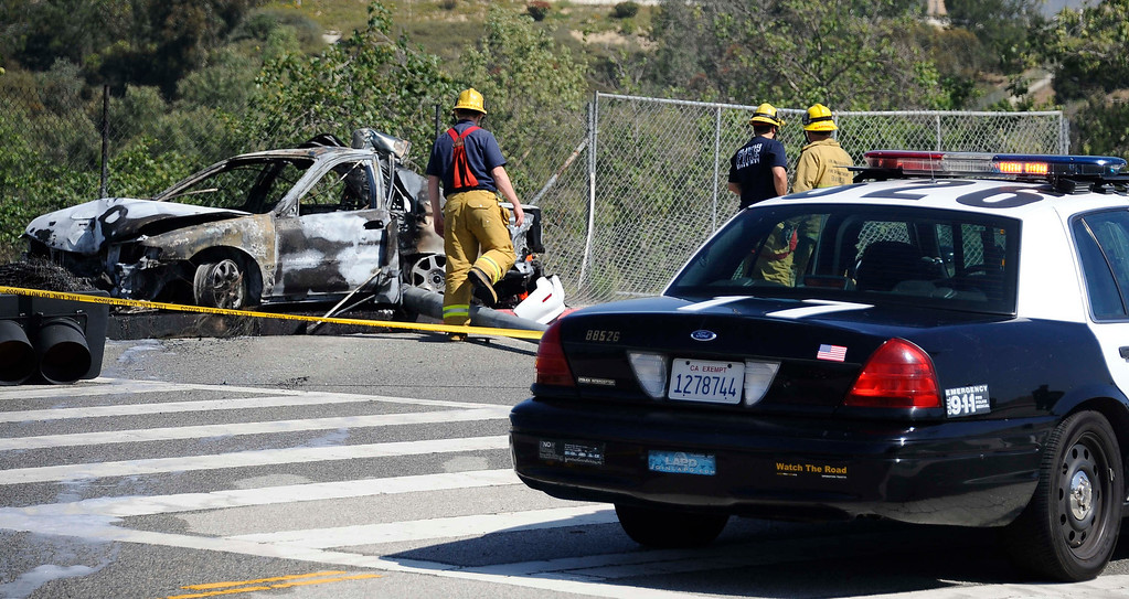 . LA city firefighters at the scene were a car crashed into a traffic light pole and burst into flames Friday morning in Porter Ranch, burning one person to death and critically injuring the driver who died later at the hospital and another who escaped from the car The crash on Rinaldi Street near Mason Avenue happened just after 10 a.m. No other vehicles appeared to be involved in the crash. The car was going at a high rate of speed down Rinaldi St. and swerved  to miss another car that was going slower and lost control and hit the traffic light poll and burst into flames. Porter Ranch California, March 29,2013 PHOTO BY Gene Blevins/LA DailyNews