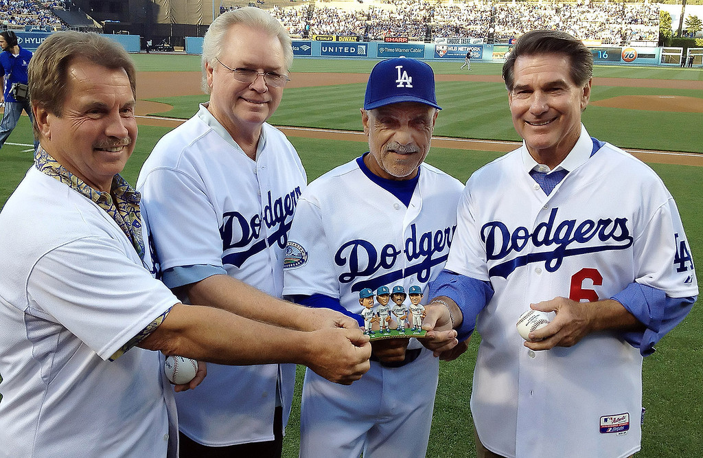 """. Bobblehead night featuring the \""""Infield\"""" from left to right Ron Cey, Bill Russell, Davey Lopes and Steve Garvey prior to a baseball game between the Milwaukee Brewers and the Los Angeles Dodgers on Tuesday, May 29, 2012 in Los Angeles. The Infield played together from 1971 to 1983.    (Keith Birmingham/Pasadena Star-News)"""