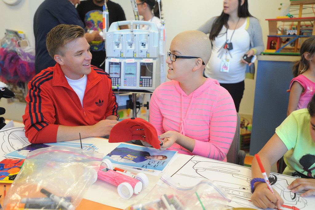 ". 04-18-2013-(LANG Staff Photo by Sean Hiller)-Toyota Grand Prix Celebrities visited Miller�s Children�s Hospital to visit the children they are raising money for through ""Racing for Kids.\""  Celebrity driver Brett Davern meets with patient Ashley Aguilar."