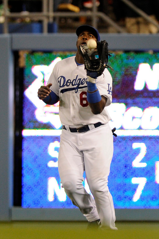 . Dodgers rookie outfielder Yasiel Puig catches a flyball for an out against the Angels, Friday, March 29, 2013, at Dodger Stadium. (Michael Owen Baker/Staff Photographer)