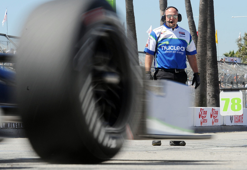 . (Will Lester/Staff Photographer) A crew member of Indycar driver Simona de Silvestro watches as the driver enters the pits Friday morning April 19, 2013 at the 39th annual Toyota Grand Prix of Long Beach.