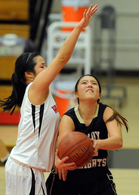 . STUDIO CITY - 02/16/13 - (Photo: Scott Varley, Los Angeles Newspaper Group)  CIF Southern Section Division IV-AA second-round girls basketball playoff game. Bishop Montgomery vs Harvard-Westlake. Bishop Montgomery won 57-42. BM\'s Christine Delapina looks for an underhand shot around Lindsey Tse.