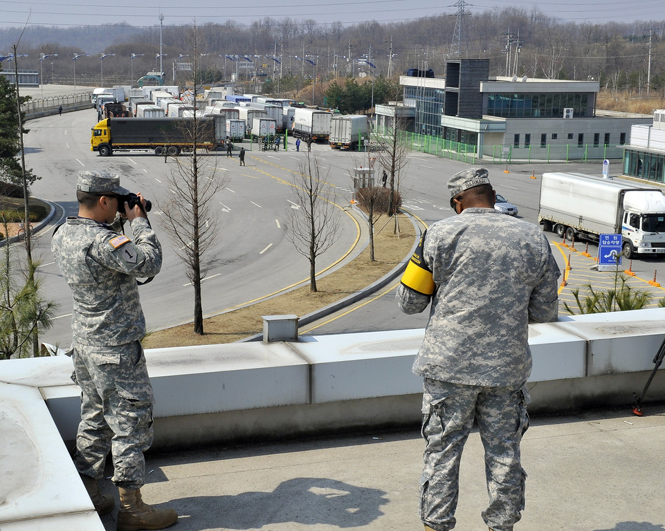 ". US soldiers take pictures as South Korean trucks return back after they were banned access to Kaesong joint industrial park in North Korea, at a military check point of the inter-Korean transit office in Paju on April 3, 2013. North Korea blocked South Korean access to a key joint industrial zone on April 3, in a sharp escalation of tensions as Washington condemned Pyongyang\'s ""dangerous, reckless\"" behaviour. AFP PHOTO / JUNG YEON-JE        (Photo credit should read JUNG YEON-JE/AFP/Getty Images)"