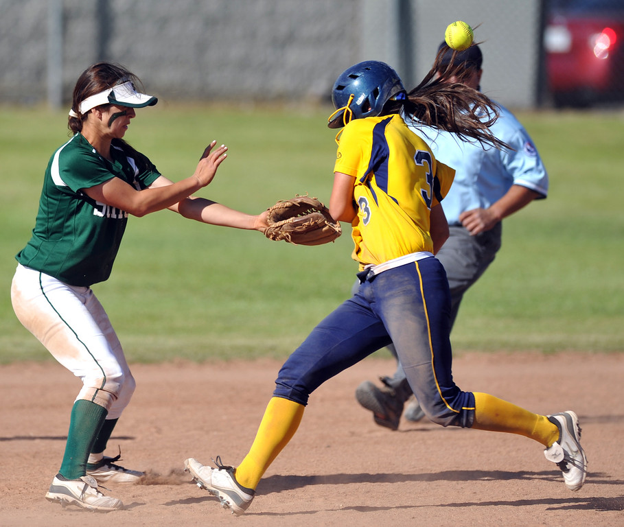 Description of . Montebello's Alyssa Soneff (#3) steals second base after getting hit by the ball thrown by the catcher as they play Schurr in their Almont League girls softball game at Montebello High School on Thursday April 18, 2013. Montebello beat Schurr 10-8. (SGVN/Staff Photo by Keith Durflinger)