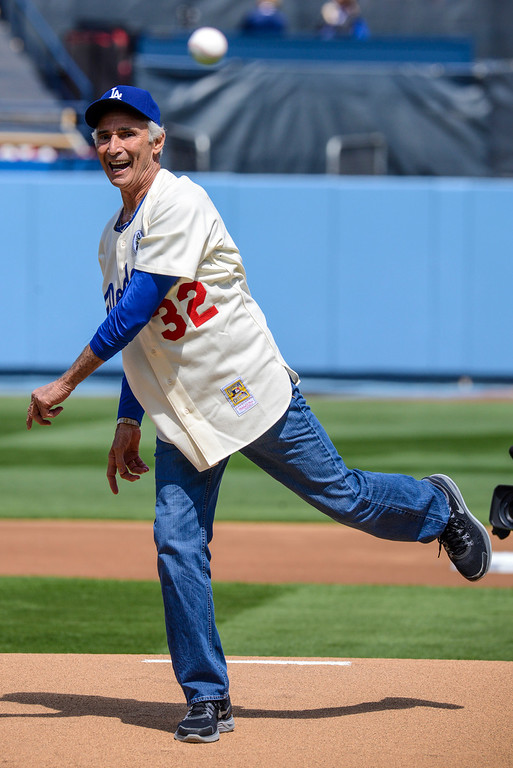 . Sandy Kofax throws out the first pitch at opening day at Dodger Stadium Monday.  Photo by David Crane/Los Angeles Daily News.