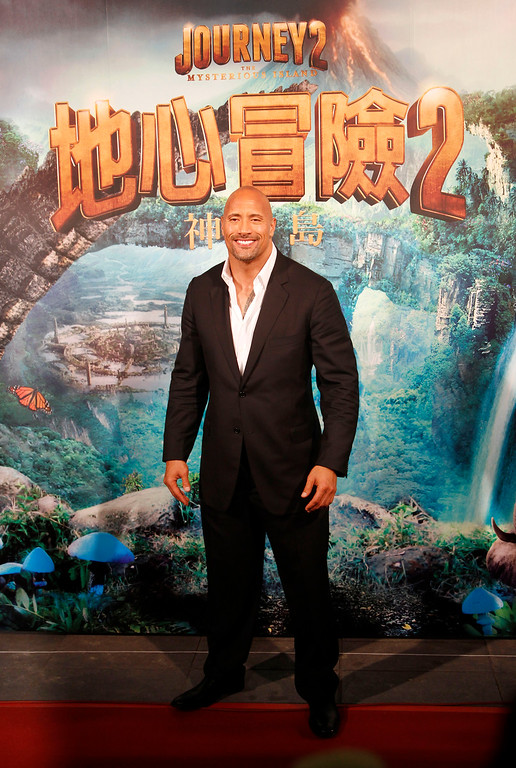 ". American actor Dwayne ""The Rock\"" Johnson arrives at the premiere of his new film \""Journey 2: The Mysterious Island\"" in Taipei, Taiwan, Wednesday, Jan. 18, 2012. (AP Photo/Wally Santana)"