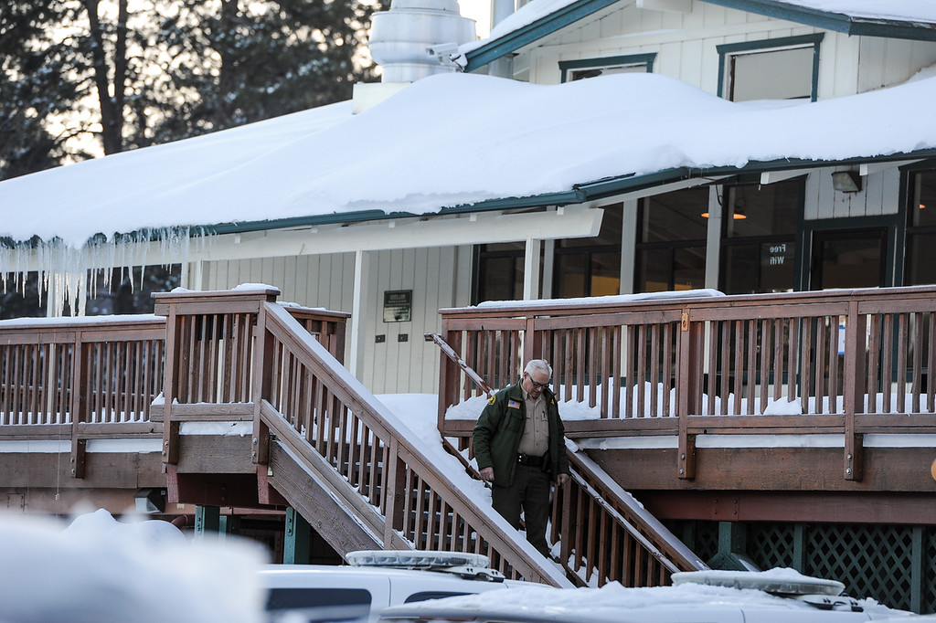 . A sheriff\'s deputy leaves the command post at Bear Mountain Resort at start of day four in the search for fugitive ex-cop Christopher Dorner in Big Bear on Sunday, Feb. 10, 2013. (Rachel Luna / Staff Photographer)