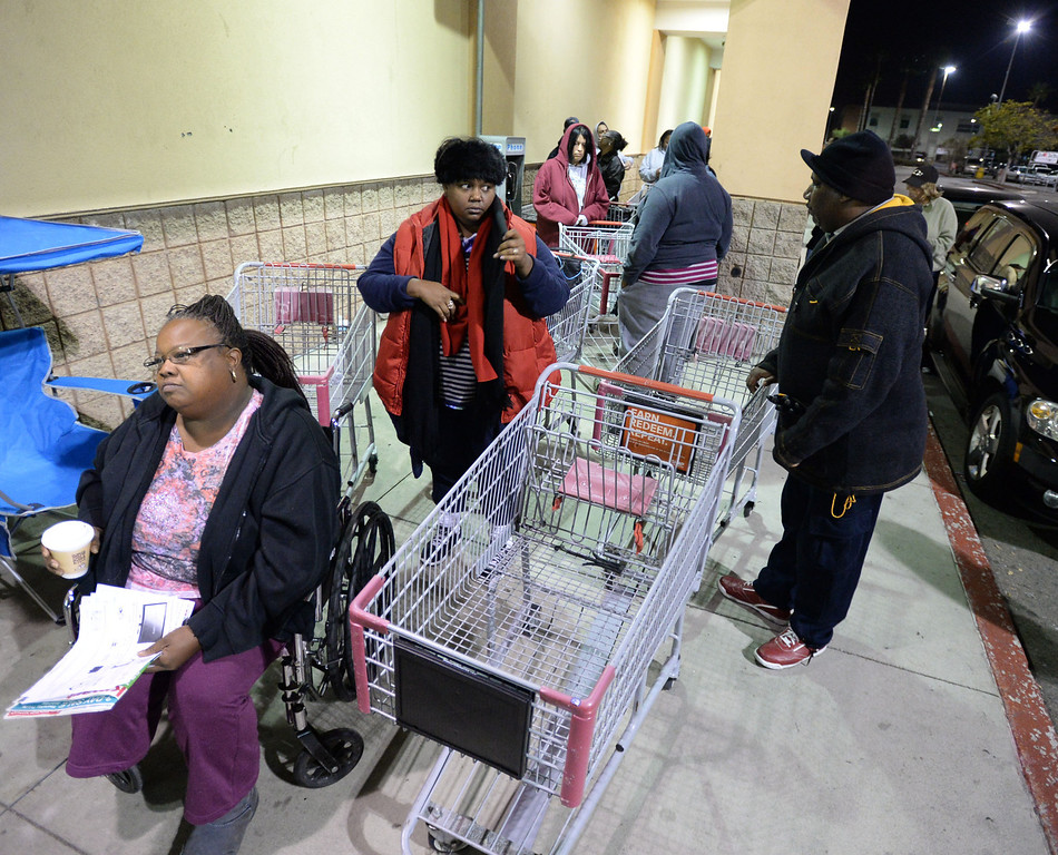 . People gather in the pre-dawn hours to be the first inside Kmart for their 6am opening Thursday, November 28, 2013, in Carson, CA. Shaefalda Thompson waits near the front of the line as the store nears opening. Photo by Steve McCrank/DailyBreeze