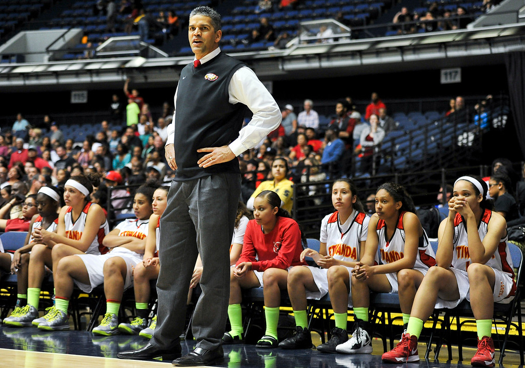 Description of . Etiwanda faces Santiago High School during the CIF-SS Div. I-AA Girls Basketball Championship game at the Anaheim Convention Center on Friday, Mar. 1, 2013. Etiwanda was defeated by Santiago 70-65. (Rachel Luna / Staff Photographer)