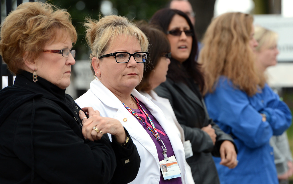 . Employees from St Bernardine Medical Center in San Bernardino watch as the funeral procession for Jeremiah MacKay passes by along Highland Avenue. Law enforcement and fire agency officials from around California and at least three other states get ready to form the funeral procession for San Bernardino Sheriff\'s Detective Jeremiah MacKay Thursday February 21, 2013 at Mt View Cemetery in San Bernardino.