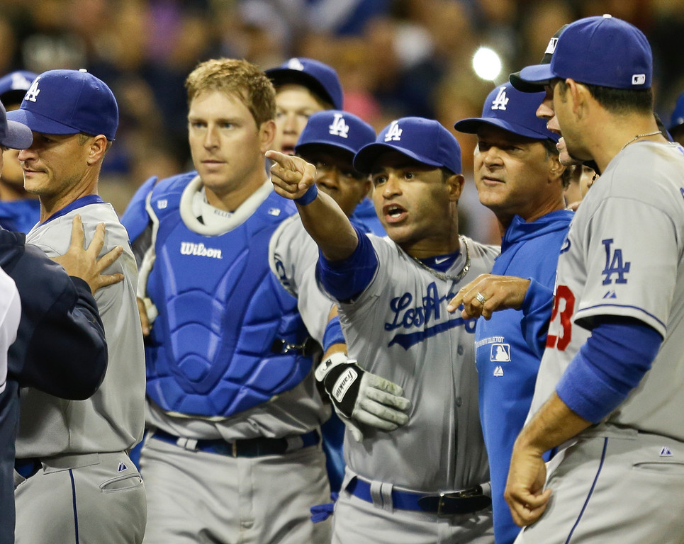 . Los Angeles Dodgers\' Jerry Hairston Jr. points at someone on the San Diego Padres as he is restrained by A.J. Ellis  after a braw that had subsided started up again during the sixth inning of baseball game in San Diego, Thursday, April 11, 2013. (AP Photo/Lenny Ignelzi)