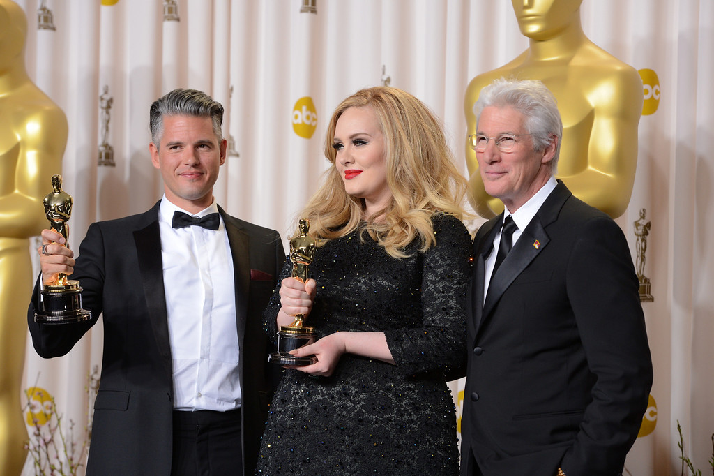Description of . musician/producer Paul Epworth  and Singer Adele won the award for best original song for