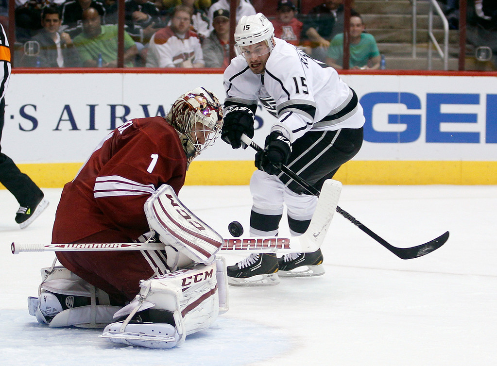 . Phoenix Coyotes goalie Jason LaBarbera, left, makes a body save on a breakaway shot by Los Angeles Kings center Brad Richardson, right, in the first period of an NHL hockey game Tuesday, April 2, 2013, in Glendale, Ariz. (AP Photo/Paul Connors)