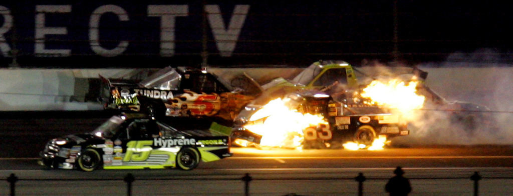 . NASCAR trucks driver P.J. Jones\' (63) car  bursts into flames as he crashes into Mike Skinner (5) but Marc Mitchell (15) gets by during the NASCAR Craftsman Trucks Series race Friday night Feb. 15, 2008 at the Daytona International Speedway in Daytona Beach, Fla. (AP Photo/Chris O\'Meara)
