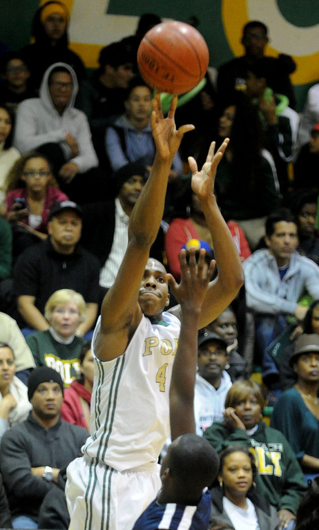 . 02-19-2012--(LANG Staff Photo by Sean Hiller)- Mayfair at Poly in the second round of the Division I-AA boys basketball playoffs Tuesday night. Poly\'s Chris Sullivan hits a three pointer over Mayfair\'s Brandon Reynolds.