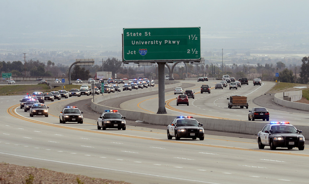 Description of . BN22-MACKAY-FUNERAL-04-JCM (Jennifer Cappuccio Maher/Staff Photographer) The funeral procession for San Bernardino County Sheriff's Detective Jeremiah MacKay heads westbound on the 210 freeway Thursday, February 21, 2013, in Rialto.