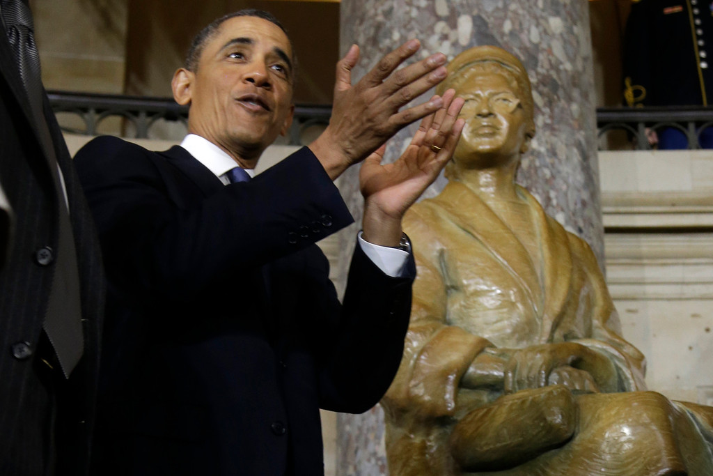 Description of . President Barack Obama applauds at the unveiling of a statue of Rosa Parks at the U.S. Capitol in Washington, Wednesday, Feb. 27, 2013. (AP Photo/Charles Dharapak)