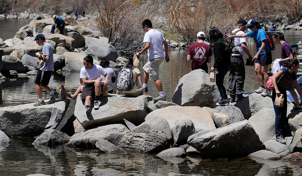 . People scamper over the rocks at Convict Lake on opening day of Trout Fishing Season in the Eastern Sierra. June Lake, CA 4/27/2013(John McCoy/Staff Photographer)