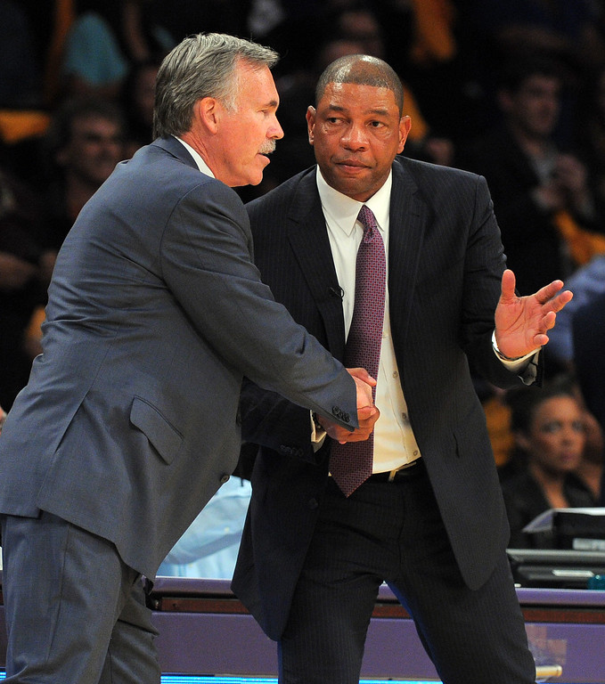. Lakers coach Mike D\'Antoni, left, and Clippers coach Doc Rivers greet each other at the end of the game in the NBA season opener between the Lakers and Clippers at Staples Center in Los Angeles, CA on Tuesday, October 29, 2013.  Lakers won 116-103. (Photo by Scott Varley, Daily Breeze)