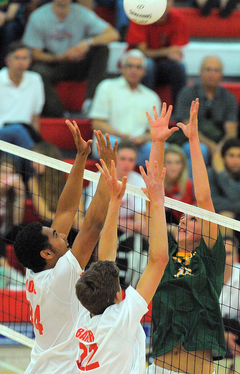 . REDONDO BEACH - 04/25/13 - (Photo: Scott Varley, Los Angeles Newspaper Group)  Mira Costa boys volleyball swept Redondo 3-0 in a Bay League matchup at Redondo. From left, Redondo\'s Nehemiah Iosia and Ryan Baker battle for control of the ball with Costa\'s Grant Chalmers.