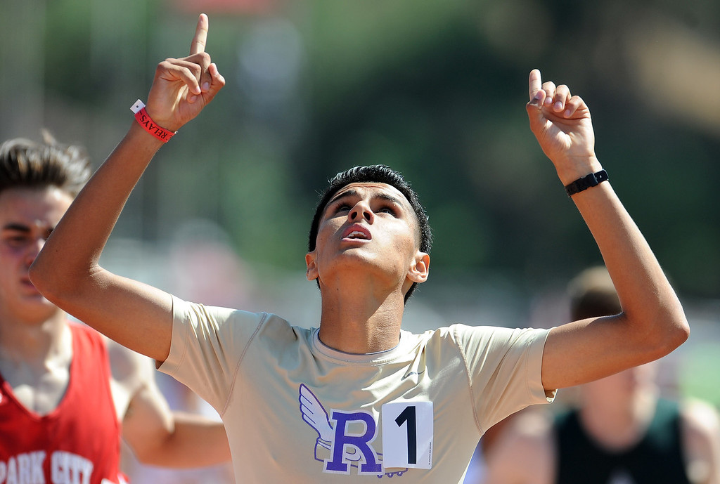 Description of . Ivan Gonzalez of Ridgeview points to the sky after winning the 800 meter invitational high school during the Mt. SAC Relays in Hilmer Lodge Stadium on the campus of Mt. San Antonio College on Saturday, April 20, 2012 in Walnut, Calif.    (Keith Birmingham/Pasadena Star-News)