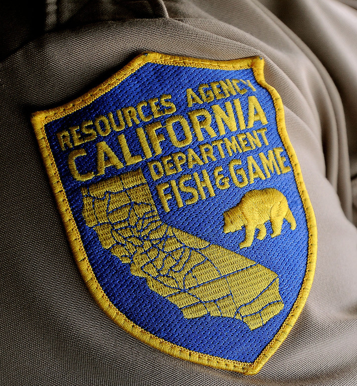 Description of . The California Department of Fish and Wildlife officers handle wildlife issues, trespassing and licensing violations in addition to standard peace officer duties.  GABRIEL LUIS ACOSTA/STAFF PHOTOGRAPHER.