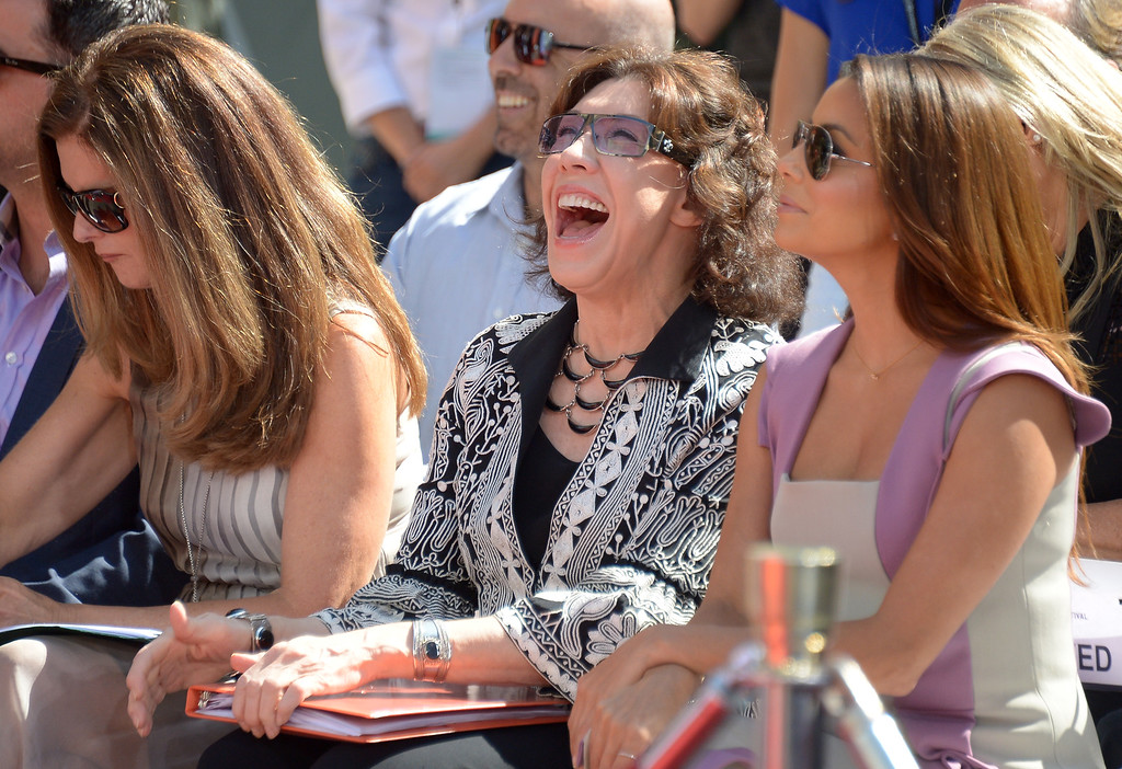 . L-R Maria Shriver , Lily Tomlin and Eva Longoria attend Jane Fonda\'s Handprint/Footprint Ceremony during the 2013 TCM Classic Film Festival at TCL Chinese Theatre on April 27, 2013 in Los Angeles. Fonda is an American actress, writer, political activist, former fashion model, and fitness guru. She rose to fame in the 1960s with films such as Barbarella and Cat Ballou. She has won two Academy Awards, an Emmy Award, three Golden Globes and received several other movie awards and nominations during more than 50 years as an actress. After 15 years of retirement, she returned to film in 2005 with Monster-in-Law, followed by Georgia Rule two years later. She also produced and starred in over 20 exercise videos released between 1982 and 1995, and once again in 2010.  (JOE KLAMAR/AFP/Getty Images)