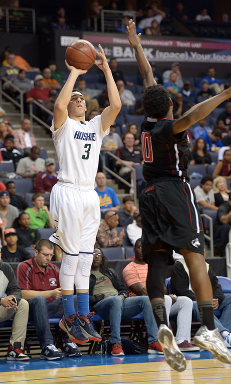 . Chino Hills\' LiAngelo Ball scores a 3-pointer at Citizens Business Bank Arena in Ontario, CA on Saturday, March 22, 2014. Chino Hills vs Centennial in the CIF boys Div 1 regional final. 1st half. Photo by Scott Varley, Daily Breeze)