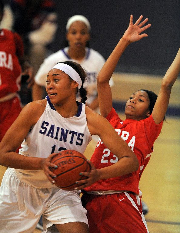 . LONG BEACH - 02/20/13 - (Photo: Scott Varley, Los Angeles Newspaper Group)  Serra and St. Anthony meet in the Quarterfinals of the Division 4AA CIF-SS girls basketball playoffs. St. Anthony\'s Kendall Cooper turns to take a shot as she\'s guarded by Caila Hailey.