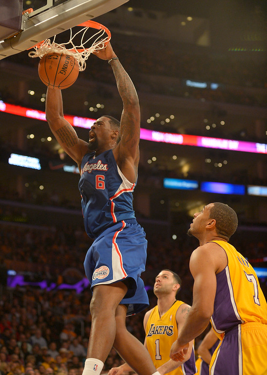 . Clippers#6 DeAndre Jordan gets past Lakers#1 Jordan Farmar and Lakers#7 Xavier Henry for a dunk in the first quarter. The Los Angeles Lakers played the Los Angeles Clippers in the opening game of the season at Staples Center. Los Angeles, CA. 10/29/2013. photo by (John McCoy/Los Angeles Daily News)