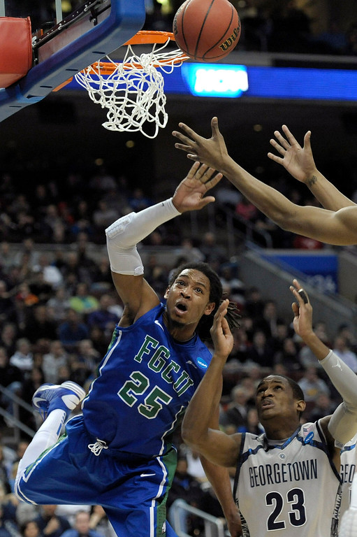 . Florida Gulf Coast\'s Sherwood Brown, left, reaches for a rebound against Georgetown\'s Aaron Bowen during the first half of a second-round game of the NCAA college basketball tournament on Friday, March 22, 2013, in Philadelphia. (AP Photo/Michael Perez)