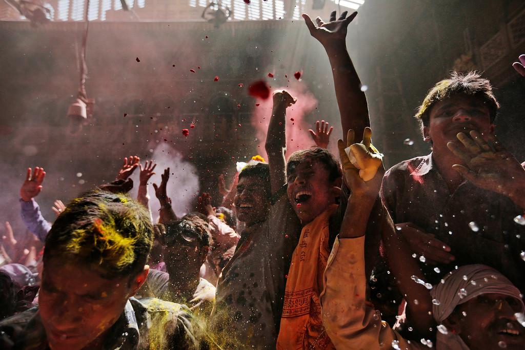 Description of . Hindu devotees celebrate seeing the deity of Krishna inside Banke Bihari temple, dedicated to Lord Krishna, during Holi festival celebrations in Vrindavan, India, Tuesday, March 26, 2013. Holi, the festival of colors celebrates the arrival of spring. (AP Photo/Kevin Frayer)