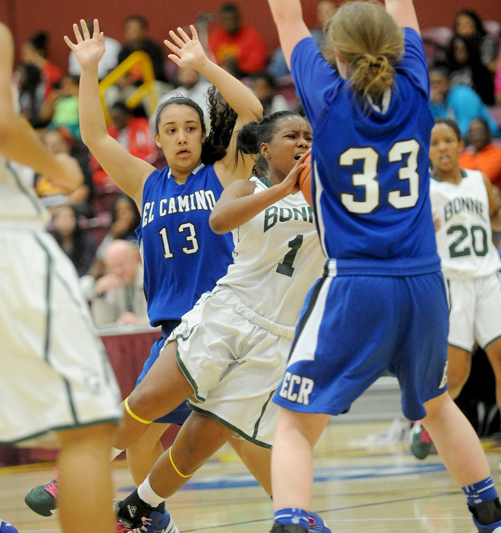 . 02-23-2012--(LANG Staff Photo by Sean Hiller)- Narbonne beat El Camino Real 47-39 in Saturday\'s L.A. City Section Division I semifinal girls basketball game. Narbonne\'s Kayla Brady (1) is heavily guarded by El Camino\'s Lindsey Rodriguez (13) and Shaina Van Stryk (33).