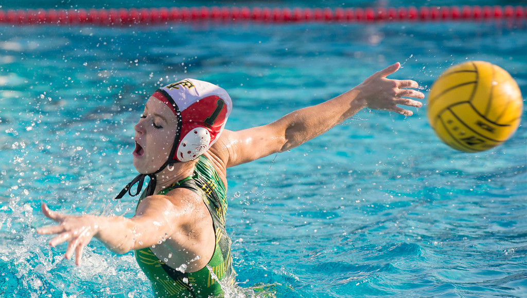 Description of . Temple City High goalie Catherine Tereszczuk lunges for a La Serna High goal shot in the CIF-SS girls water polo first-round game at Whittier High Feb. 14, 2013.   (SGVN/Staff photo by Leo Jarzomb)