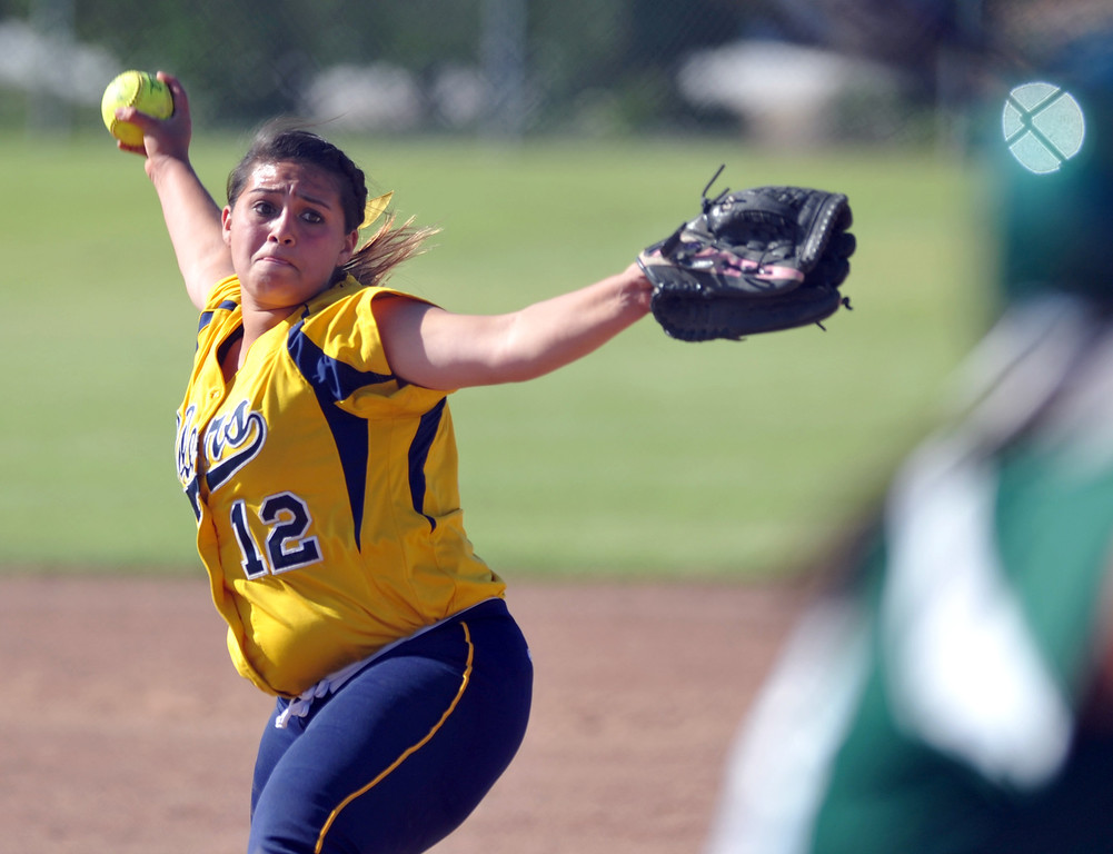 Description of . Montebello's Evelyn Hernandez (#12) makes a pitch as they play Schurr in their Almont League girls softball game at Montebello High School on Thursday April 18, 2013. Montebello beat Schurr 10-8. (SGVN/Staff Photo by Keith Durflinger)