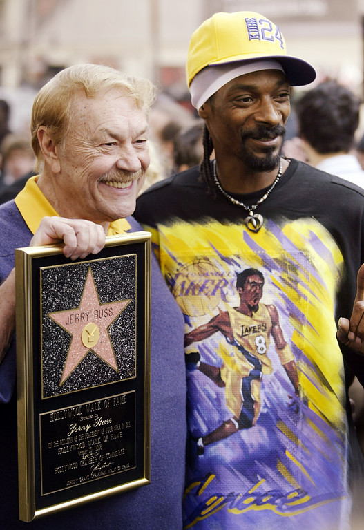 Description of . Jerry Buss, left, owner of the Los Angeles Lakers team, poses with Snoop Dogg, after Buss was honored with a television star on the Hollywood Walk of Fame in the Hollywood section of Los Angeles, Monday, Oct. 30, 2006. (AP Photo/Damian Dovarganes)