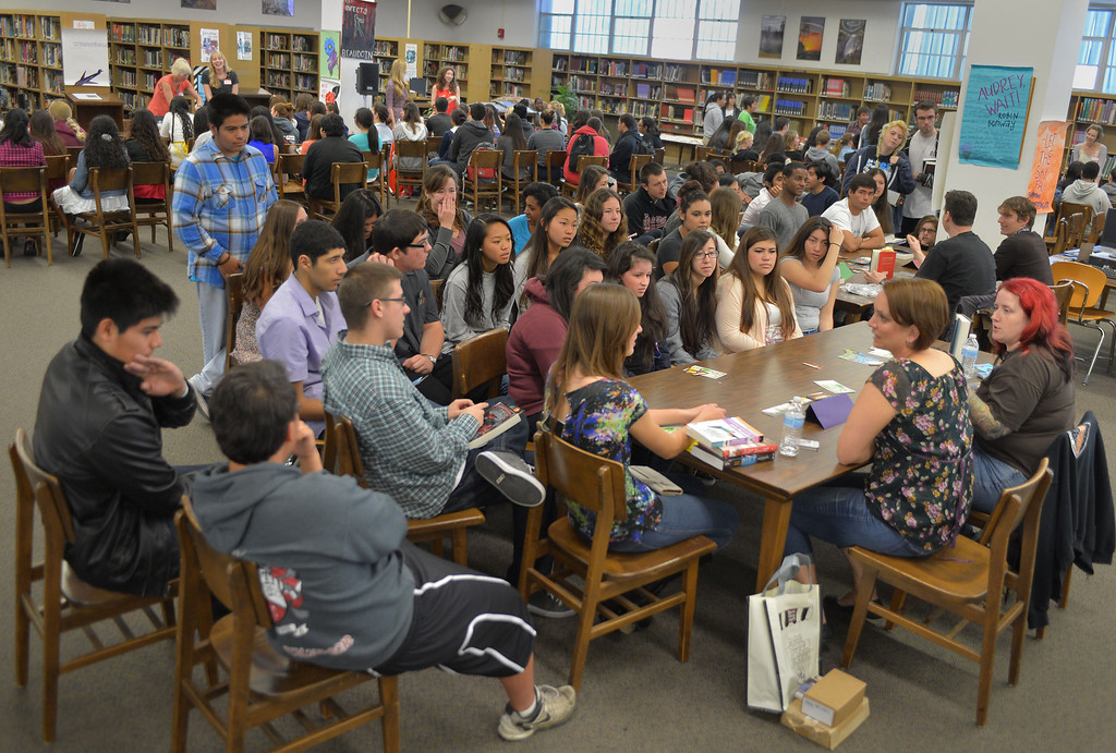 . 0330_NWS_TDB-L-AUTHOR--- Torrance, CALIFORNIA--3/29/13--- Staff Photo: Robert Casillas / LANG---  The 2nd Annual Torrance High School Author Fair was held Friday on campus. 21 authors attended and shared their writing experiences with students. The fair is the brain child of student Ishita Singh. Students rotated to different tables to listen to writers.