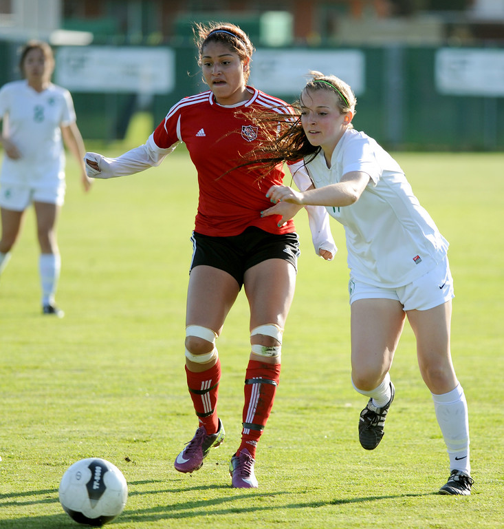 . 02-21-2012--(LANG Staff Photo by Sean Hiller)- South Torrance girls soccer beat Artesia 5-0 in Thursday\'s CIF Southern Section Division IV quarterfinal at South High. Artesia\'s 	Daisy Briseno, left, battles South\'s Cassidy Griego (17).