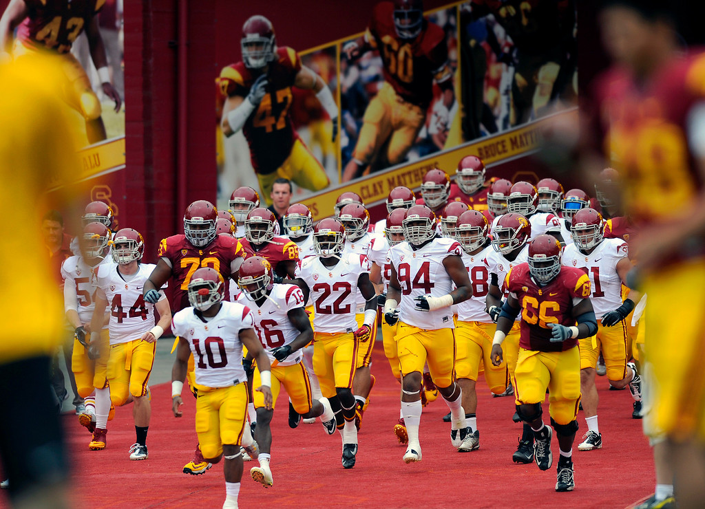 . Players run onto the field for the second half of USC\'s Spring Football Game. (Michael Owen Baker/Staff Photographer)