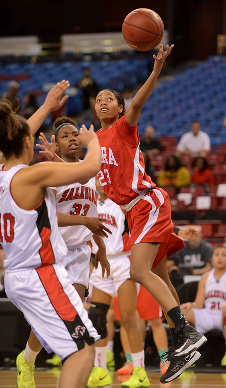 . Serra High School\'s Jenny Albano puts up a shot against Salesian High during the Division IV 2013 CIF State Basketball Championships at Sleep Train Arena, in Sacramento, Ca March 23, 2013.(Andy Holzman/Los Angeles Daily News)