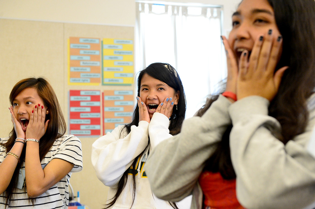 Description of . From left, Annu Vue, 15, Olivia Lim, 15, and Amber Ho, 17, do singing exercises in a Pop Rock Vocal class during the 4th Annual San Gabriel Youth Summit at Columbia School in El Monte Saturday, March 23, 2013. (SGVN/Staff Photo by Sarah Reingewirtz)