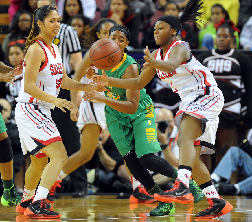 . Players go after a loose ball at Sleep Train Arena in Sacramento, CA on Saturday, March 29, 2014. Long Beach Poly vs Salesian in the CIF Open Div girls basketball state final. 2nd half. Poly won 70-52. (Photo by Scott Varley, Daily Breeze)