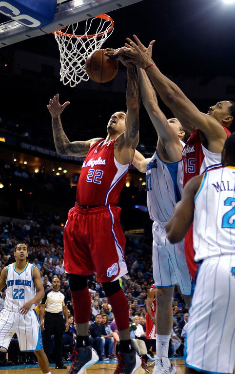 . Los Angeles Clippers small forward Matt Barnes (22) and New Orleans Hornets power forward Lou Amundson (17) battle for a rebound in the first half of an NBA basketball game in New Orleans, Wednesday, March 27, 2013. The Clippers won 105-91. (AP Photo/Gerald Herbert)