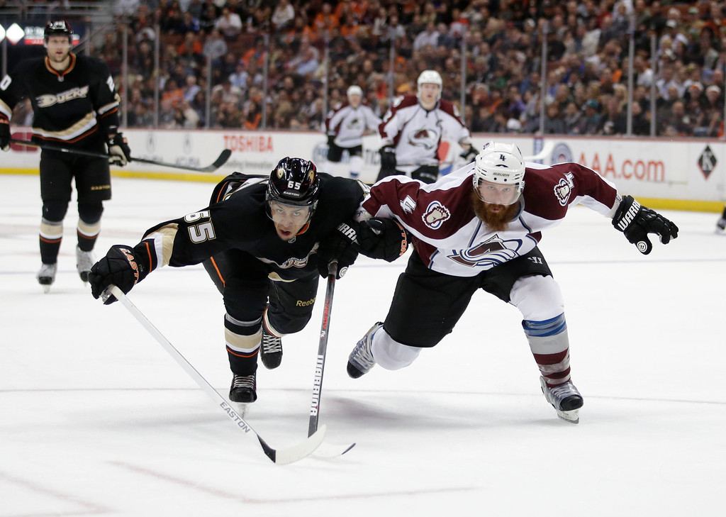 . Anaheim Ducks\' Emerson Etem, left, and Colorado Avalanche\'s Greg Zanon go after the puck during the second period of an NHL hockey game in Anaheim, Calif., Wednesday, April 10, 2013. (AP Photo/Jae C. Hong)