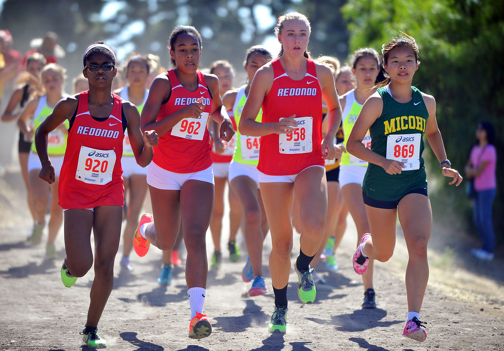 . Peninsula High hosted a Bay League cross country meet in Palos Verdes Estates, CA on Thursday, September 26, 2013.  Mira Costa\'s Abby Hong, right, fends off a group of Redondo runners at the start of the race to go on to win the race. (Photo by Scott Varley, Daily Breeze)