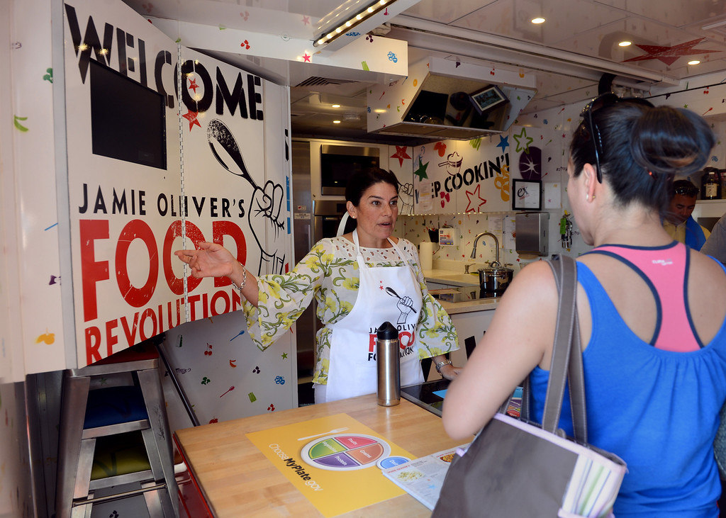 ". Program Trainer Lisa Fontanesi talks about the Jamie Oliver Food Foundation\'s ""Big Rig Teaching Kitchen\"" at the L.A. County Fair at Fairplex in Pomona. (Jennifer Cappuccio Maher/Inland Valley Daily Bulletin)"